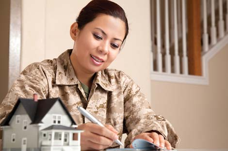 Woman in military gear writing on paper